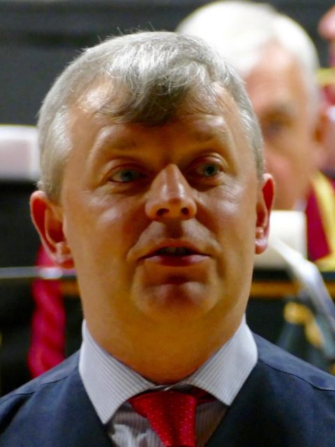 Addressing the audience at Middleton Band's joint concert with Neo Brass June 2016